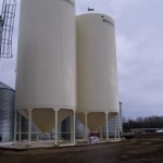 Rig mats used as a base to support 2-200 tonne fertilizer bins. (approximately 900,000 lbs. is supported by 2-8' x 40' mats)