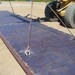 Steel plated mat with 8.5 tonne lifting shackles for Precision Drilling.