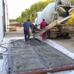 Filling mat with concrete.